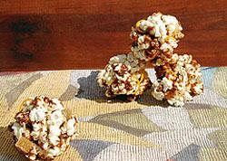14_orange_ginger_caramel_popcorn_balls__by_feedingmaybelle.jpg